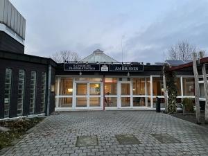 Eingang zum Katholischen Franziskus Zentrum und zur Gaststätte am Brunnen im Ökumenischen Gemeindezentrum Dortmund-Scharnhorst